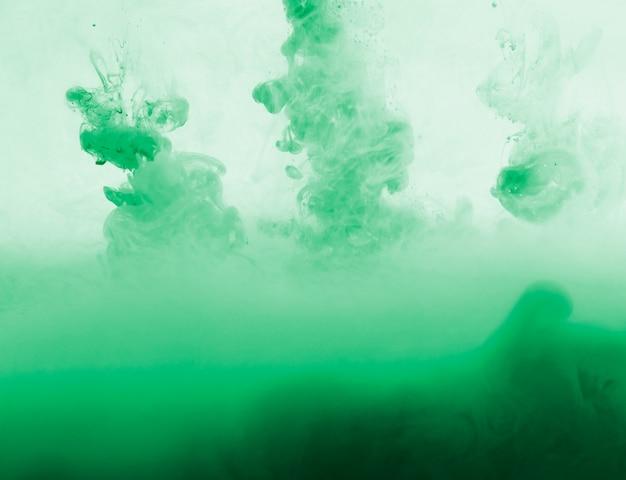 Nuvem verde denso abstrata da neblina no greenness