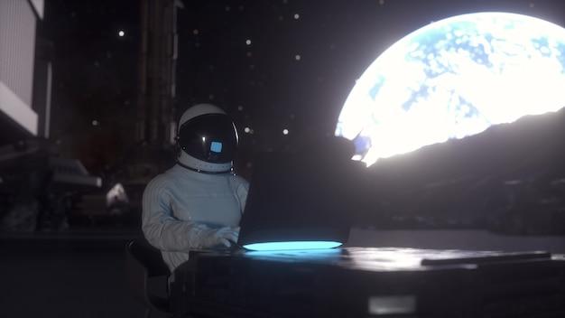 O astronauta trabalha em seu laptop de ciências em uma colônia espacial em um dos planetas. renderização 3d.