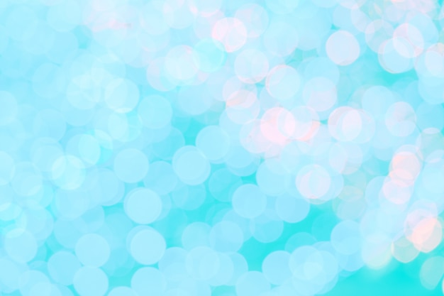 O bokeh abstrato ilumina o fundo azul da cor.