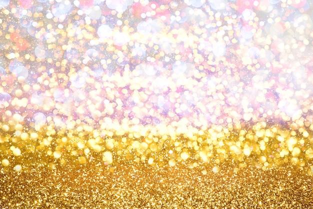 O brilho do ouro ilumina o fundo do sumário do bokeh da textura. desfocado