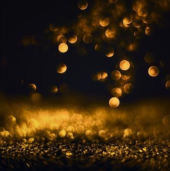 O brilho ilumina o fundo do grunge, brilho defocused abstraia luzes twinkly e o fundo claro de natal das estrelas do brilho.