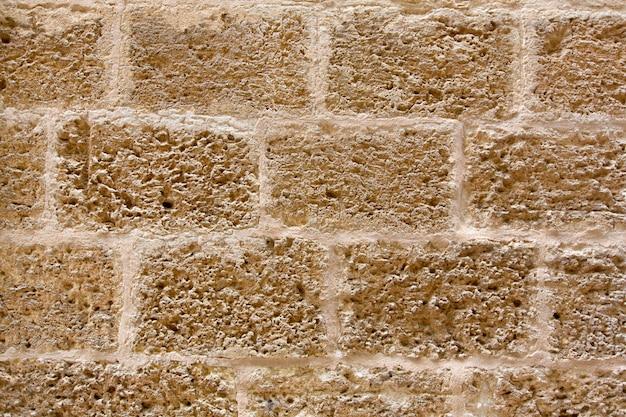 O castelo de menorca stonewall a textura da parede de alvenaria do ashlar