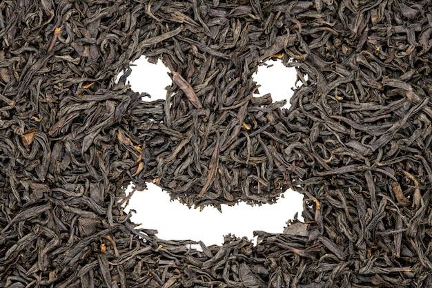 O chá do souchong de lapsang, sorriso engraçado enfrenta dado forma, ascendente próximo.