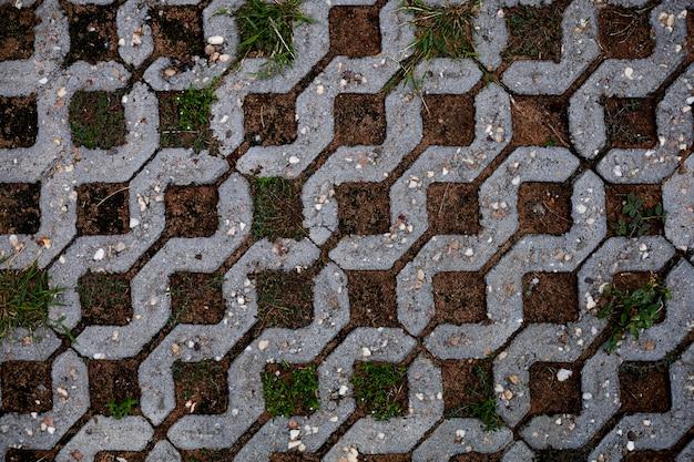 O chão de ladrilhos de tijolos brancos