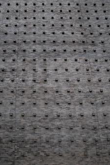 O clássico vintage velho bloco de pedra de tijolo cube na parede com a telha e padrão sem emenda.