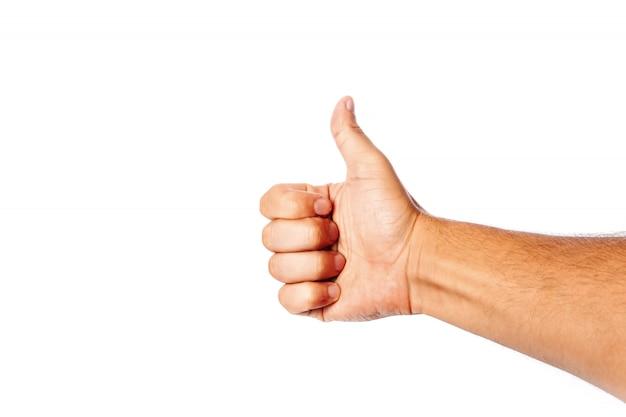 O close-up masculino da mão em um branco mostra um gosto. isolar.