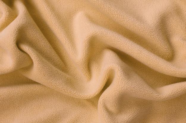 O cobertor de tecido de lã laranja peludo.