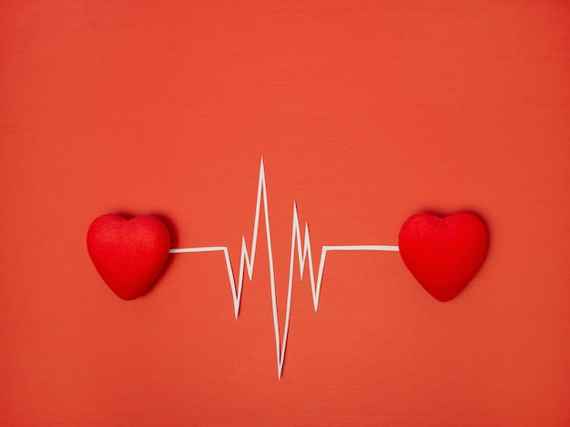 O conceito de dia dos namorados o ritmo de dois corações, batimento cardíaco, eletrocardiograma