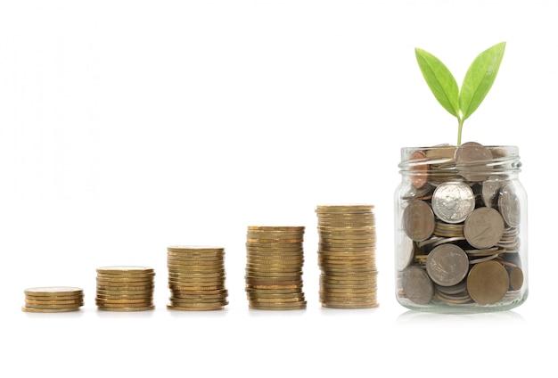 O conceito do investimento, moedas representa graficamente o mercado de valores de ação conceito do dinheiro da economia.