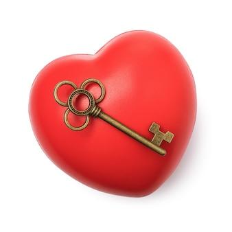 O conceito sobre o tema da chave do coração isolado no fundo branco