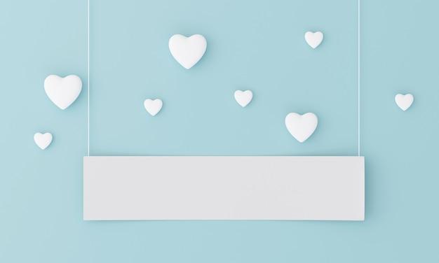 O coração de manya flutua sobre um fundo azul claro pastel com um rótulo em branco para inserir letras. doce conceito dos namorados.
