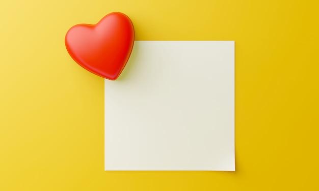 O coração vermelho está sobreposto no canto do papel quadrado em branco. para inserir texto em um fundo amarelo. doce conceito dos namorados.