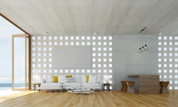 O design interior da sala e da sala de estar e o fundo da parede de concreto e vista para o mar Foto Premium