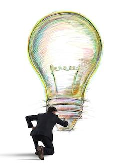 O empresário desenha na parede uma grande lâmpada colorida com cores brilhantes