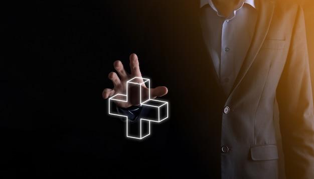 O empresário segura 3d ícone de adição, o homem segura na mão oferece coisas positivas, como lucro, benefícios, desenvolvimento, rsc representado pelo sinal de mais. a mão mostra o sinal de mais