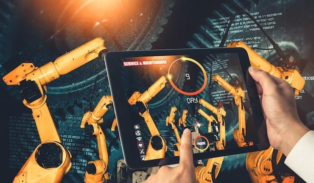 O engenheiro controla os braços robóticos com a tecnologia de realidade aumentada da indústria