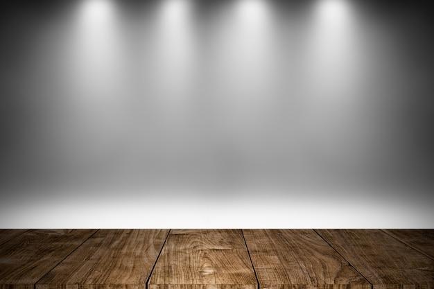 O estágio de madeira ou o assoalho de madeira com iluminação branca decoram o projeto do fundo para produtos da mostra