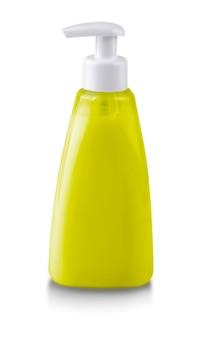 O frasco de sabão bomba de plástico amarelo sem rótulo isolado no fundo branco
