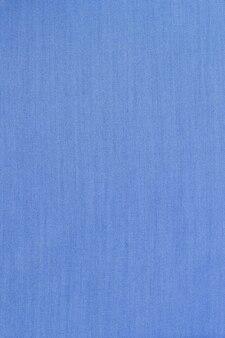 O fundo azul da textura do tecido. vazio. nenhum padrão