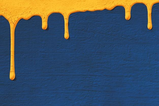 O fundo com textura da parede concreta do estuque no azul em que gotas a tinta amarela flui para baixo.
