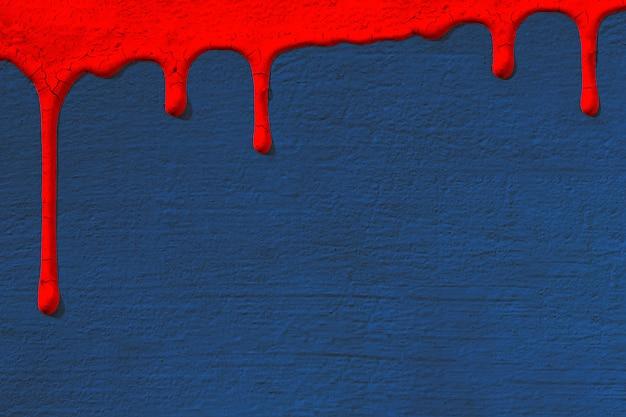 O fundo com textura da parede concreta do estuque no azul em que gotas a tinta vermelha flui para baixo. textura do conceito, reparação, cor