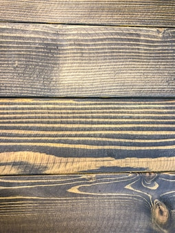 O fundo da foto da madeira pintou a textura preta, de madeira.