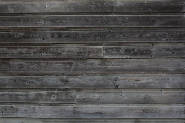 O fundo da madeira pintada cinza resistida