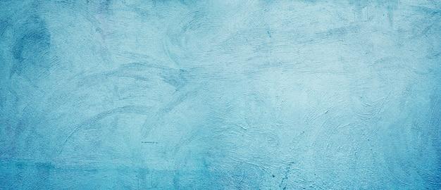 O fundo da parede de estuque é azul. parede de gesso decorativo abstrato grunge.