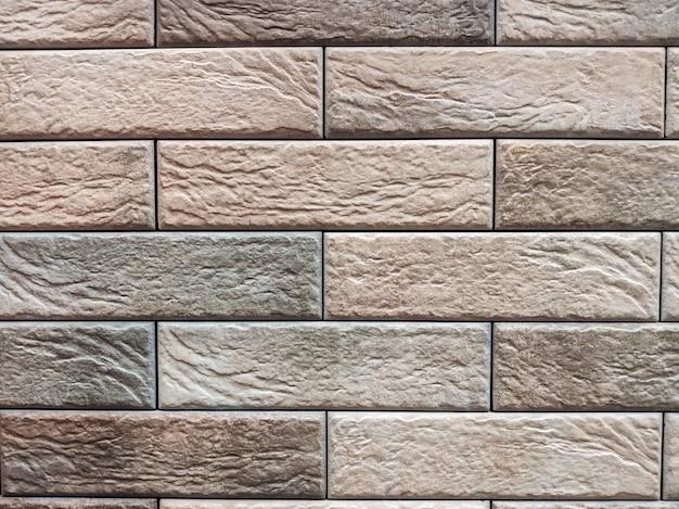 O fundo da parede é uma superfície de tijolo marrom. parede abstrata.