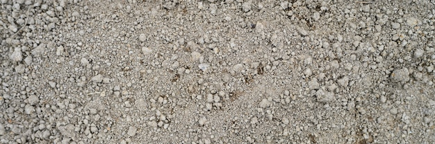 O fundo da textura à terra afrouxada do solo da terra secada com nada nela, apronta-se para plantar.