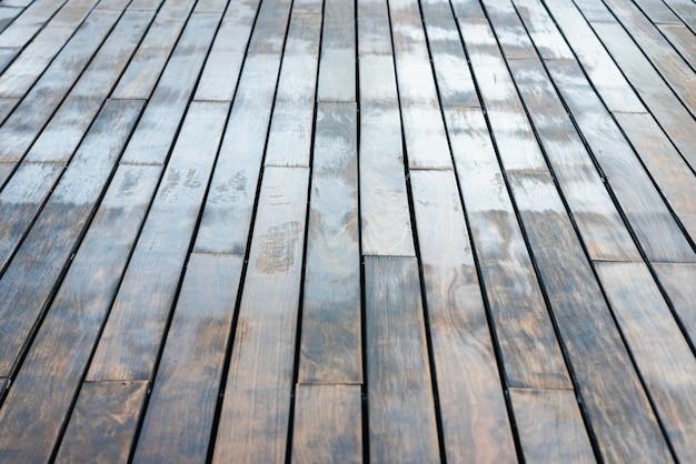 O fundo das madeiras arranjou em tabelas envelhecidas de tons silenciado.