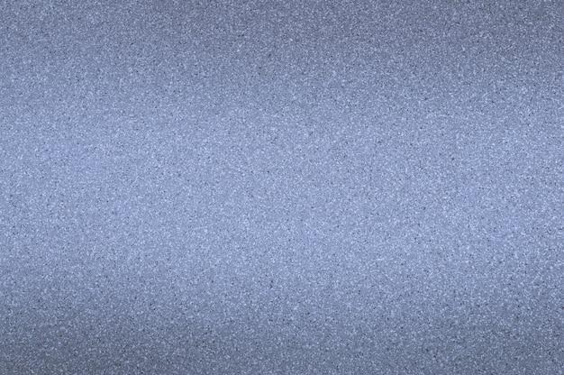 O fundo de granito é azul claro com pequenos pontos. escurecimento da parte superior e inferior.