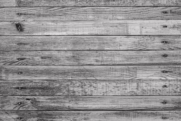 O fundo de textura de madeira antiga com padrões naturais
