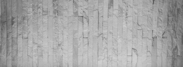 O fundo de textura de padrão de parede de pedra branca.