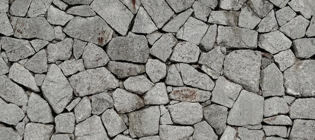 O fundo do teste padrão da textura da parede de pedra.
