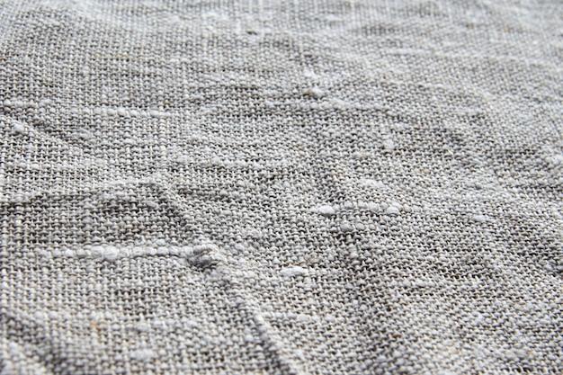O fundo e a textura são o tecido de linho grosseiro cinzento com um weave próximo amarrotado ligeiramente.