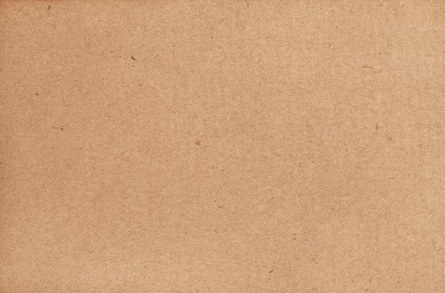 O fundo marrom do sumário da folha do cartão, textura de recicla a caixa de papel no teste padrão velho do vintage para o trabalho de arte do projeto.