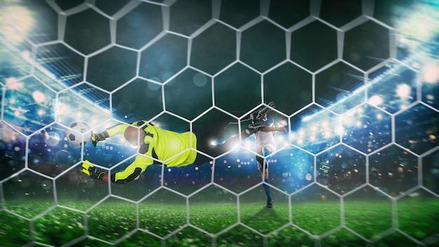 O goleiro pega a bola no estádio durante um jogo de futebol