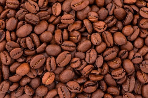 O grão perfumado torrado. textura de grãos de café