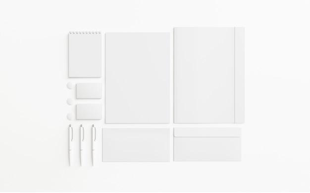 O jogo em branco dos artigos de papelaria isolado no branco, 3d rende.