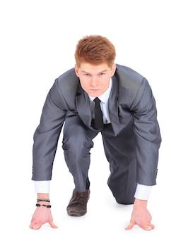 O jovem empresário bonito isolado em um fundo branco.