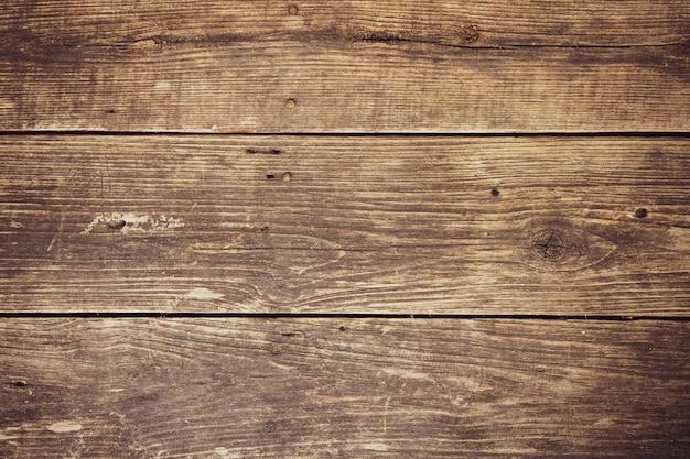 O marrom escuro velho vazio do grunge pregou a madeira dura. textura de fundo horizontal de prancha.
