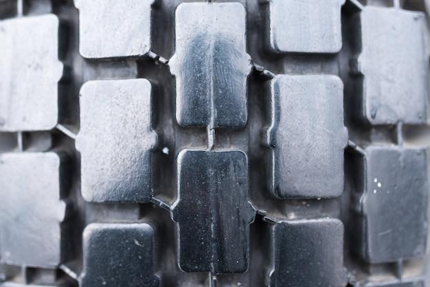 O padrão da banda de rodagem do pneu, a textura do fundo