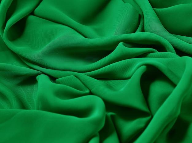 O pano abstrato verde, tecido e textura, teatro de cortina
