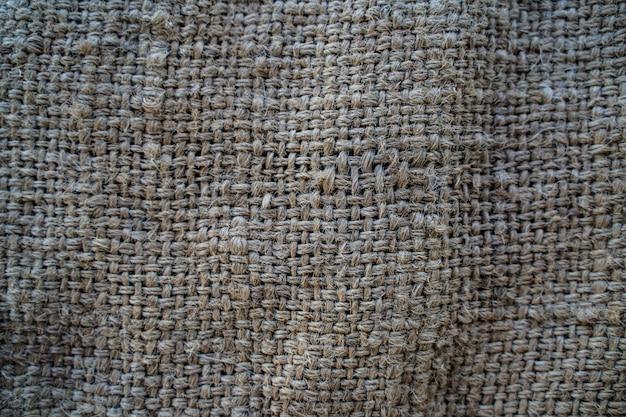O pano de saco de hesse tecido textura de fundo na cor bege creme amarelo claro