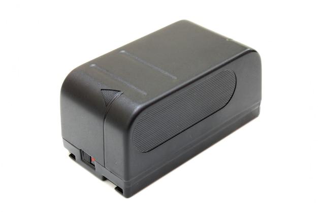 O pequeno acumulador retangular preto de uma câmera de vídeo