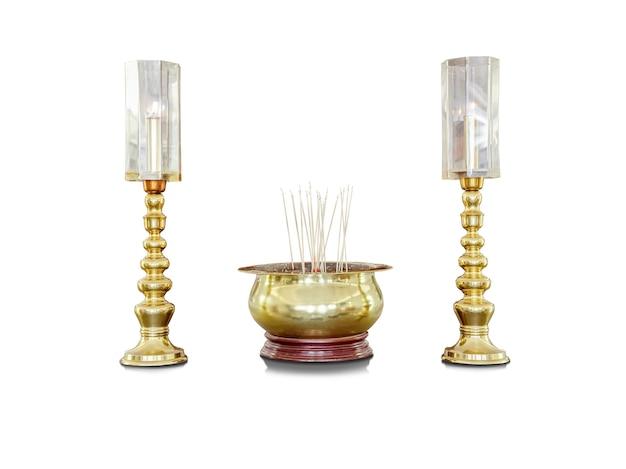 O pote de incenso dourado e o pote de vela