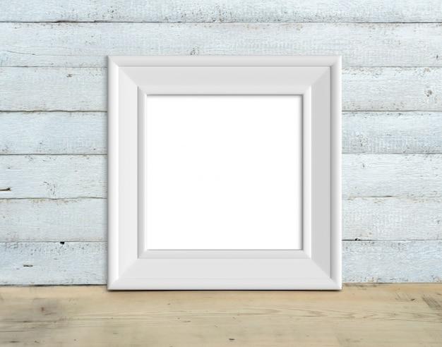 O quadro de madeira branco do vintage quadrado está em uma tabela de madeira 3d rende.