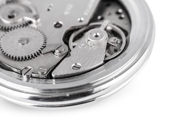 O relógio mecânico antigo aberto