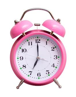 O relógio rosa em um show isolado branco 7 horas